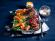 Vegan rollade met cranberry-portjus, hasselback zoete aardappelen en bonenrolletjes
